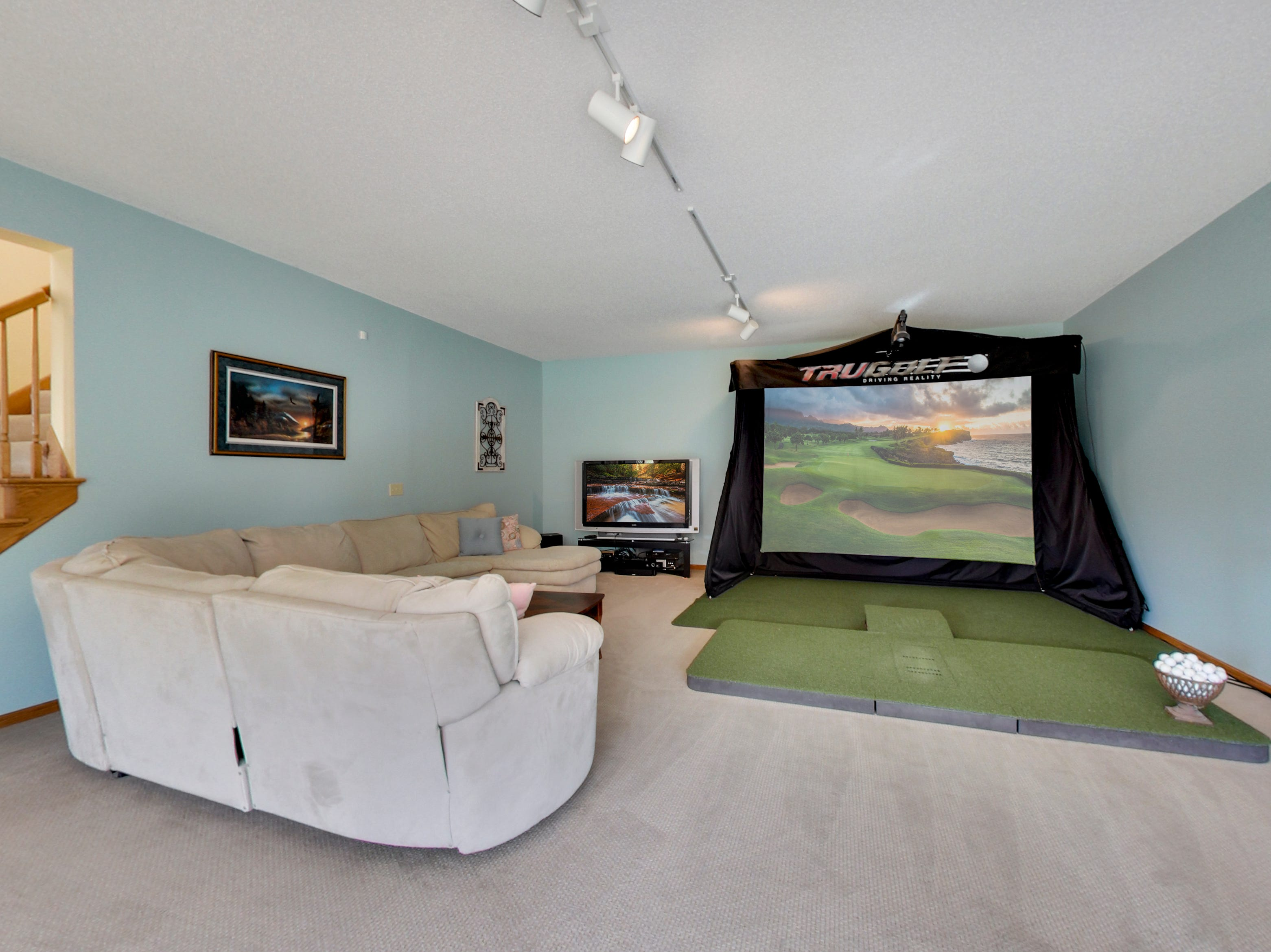 The lower floor has a 40-foot long utility room as well as a spacious game room and amusement room.