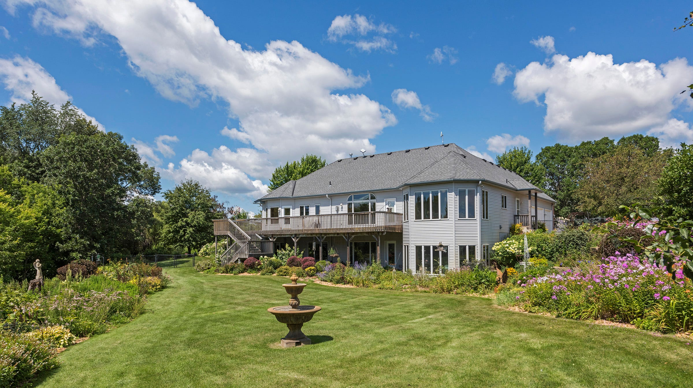 The lawn immediately surrounding the home is lavishly adorned with gorgeous gardens that are a green thumb's dream.