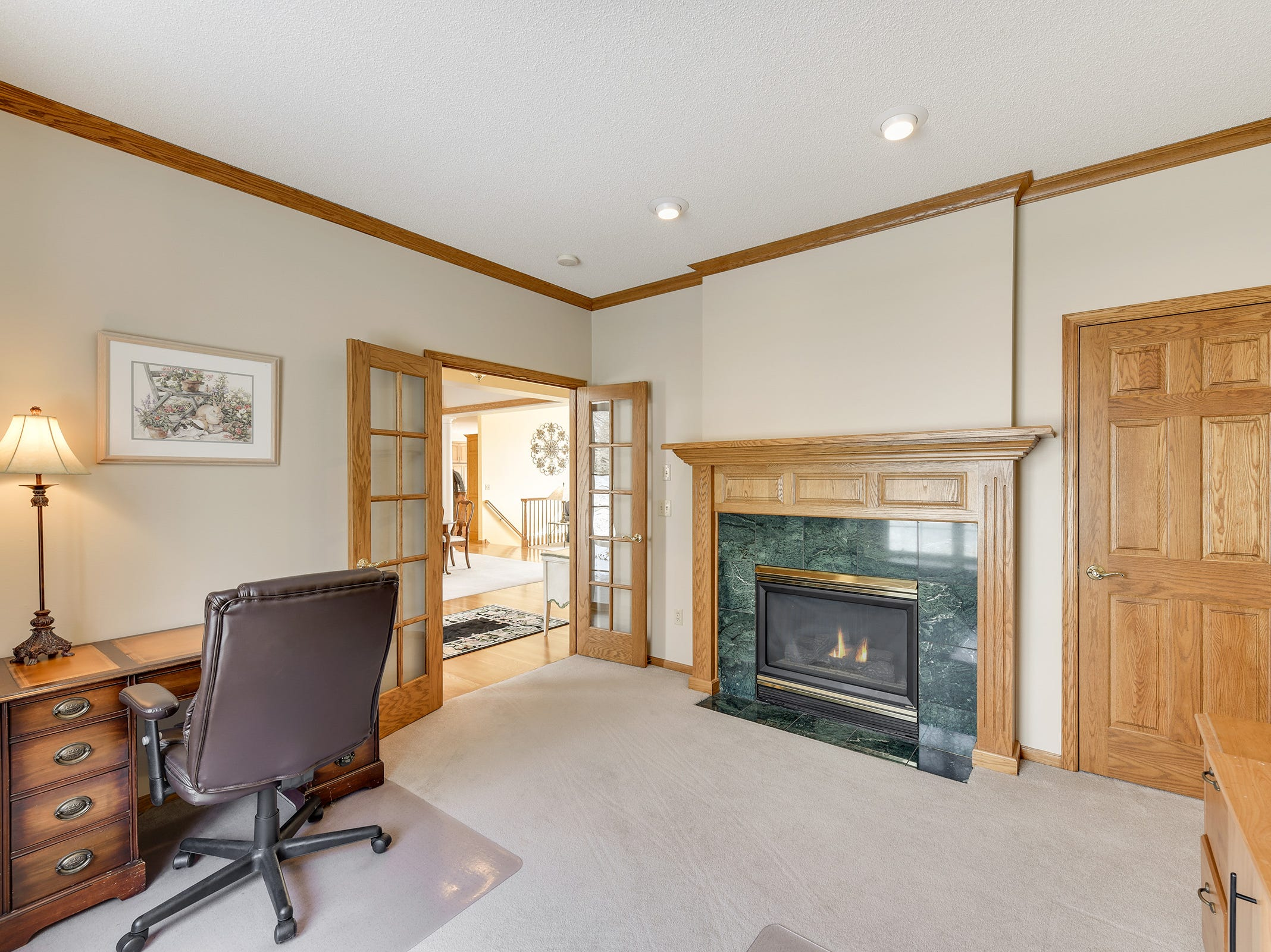 The office features a gas fireplace and natural woodworking.