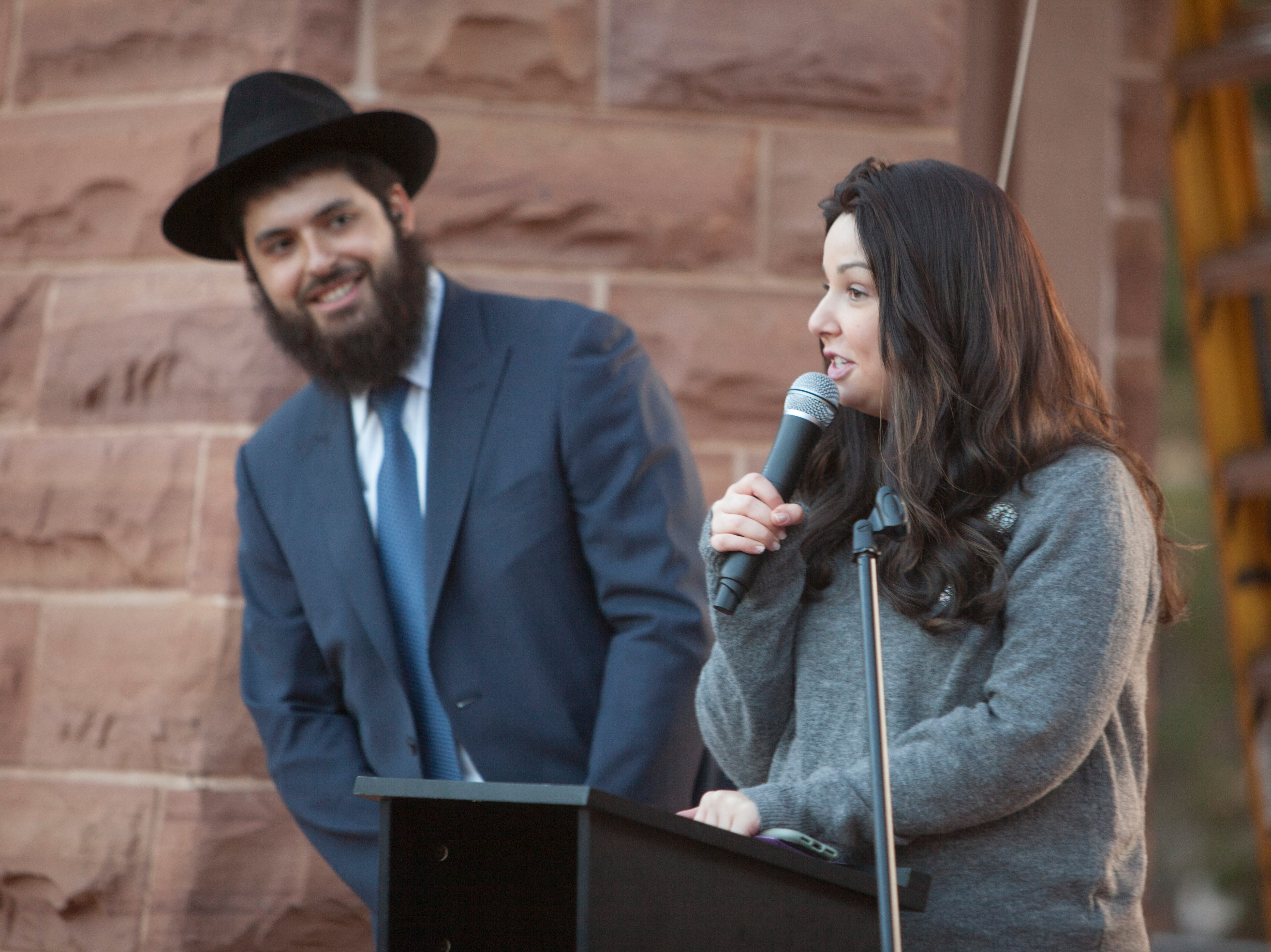 Under the direction of Rabbi Mendy Cohen members of the St. George community gather at town square to celebrate Hanukkah Sunday, Dec. 9, 2018.