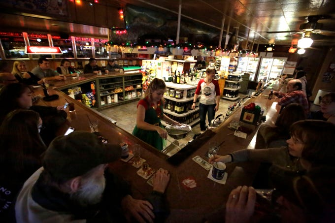 Bartender Donna Seidler prepares a Tom and Jerry on Friday, December 7, 2018, at The Domino Bar in Wausau, Wis. The Domino serves the popular drink every year, from Thanksgiving until New Year's Day.Tork Mason/USA Today NETWORK-Wisconsin