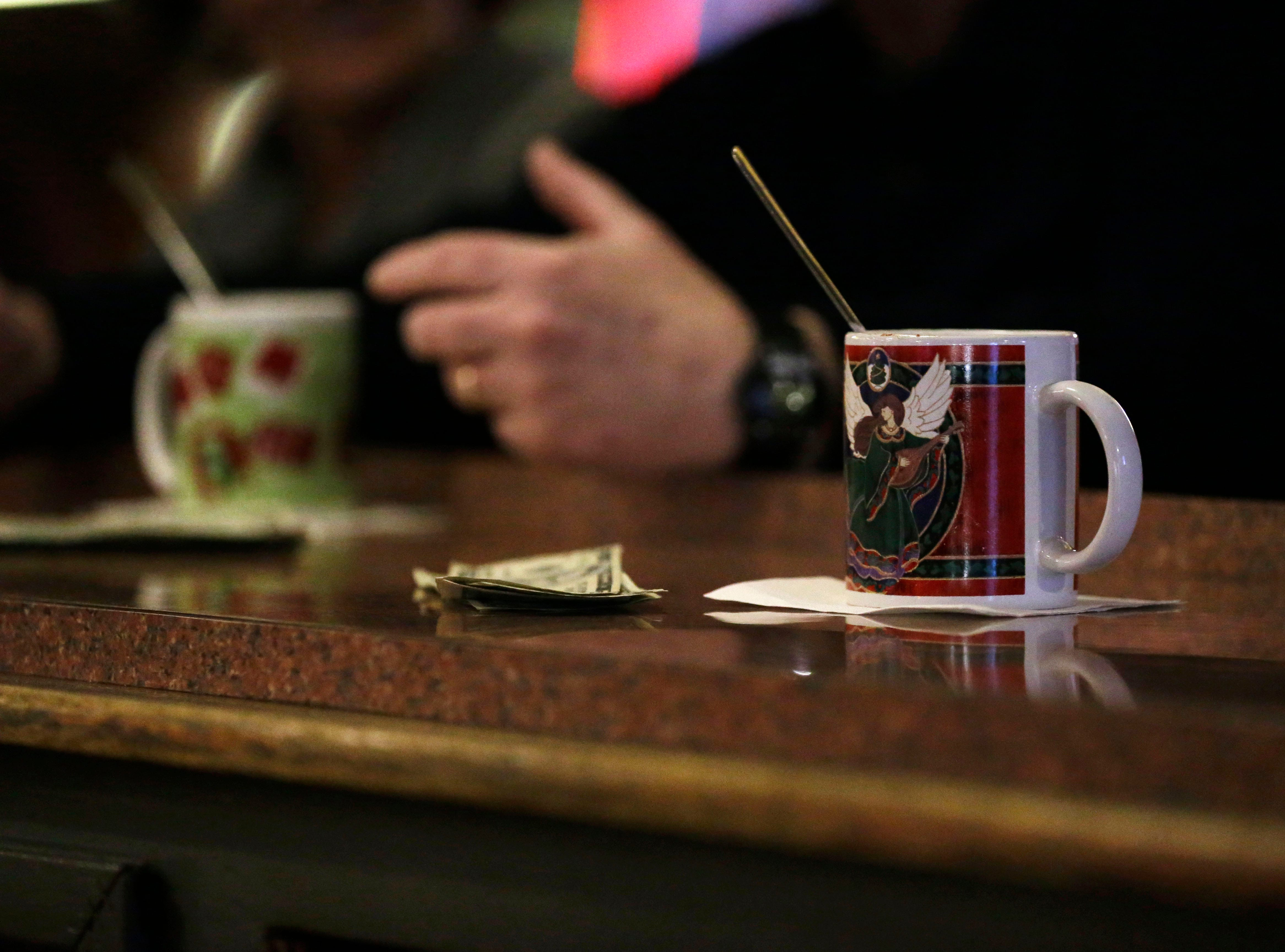 Patrons enjoy Tom and Jerrys on Friday, December 7, 2018, at The Domino Bar in Wausau, Wis. The Domino serves the popular drink every year, from Thanksgiving until New Year's Day. Tork Mason/USA Today NETWORK-Wisconsin
