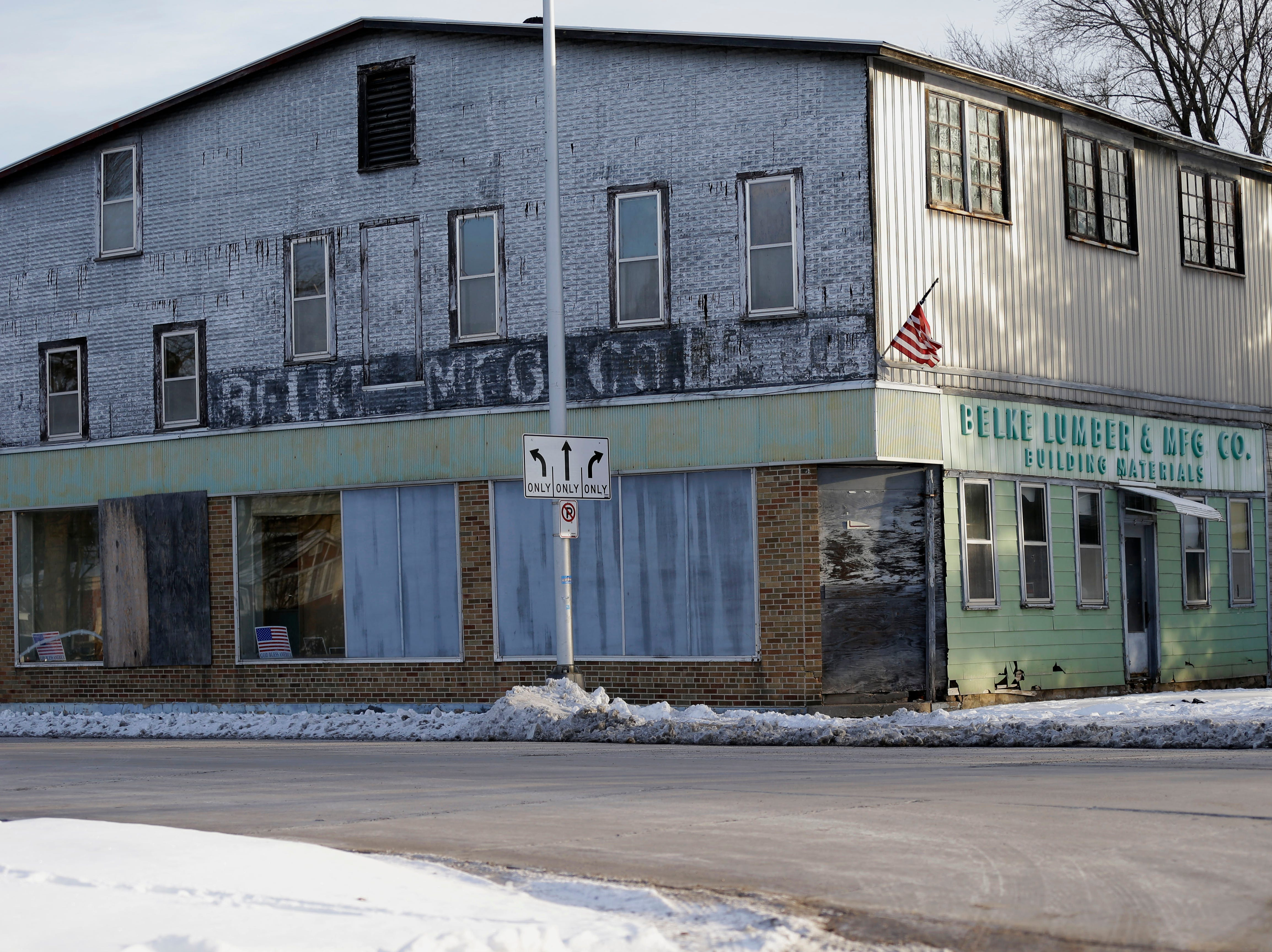 Developer proposes turning old Belke Lumber site into stores where owners could live