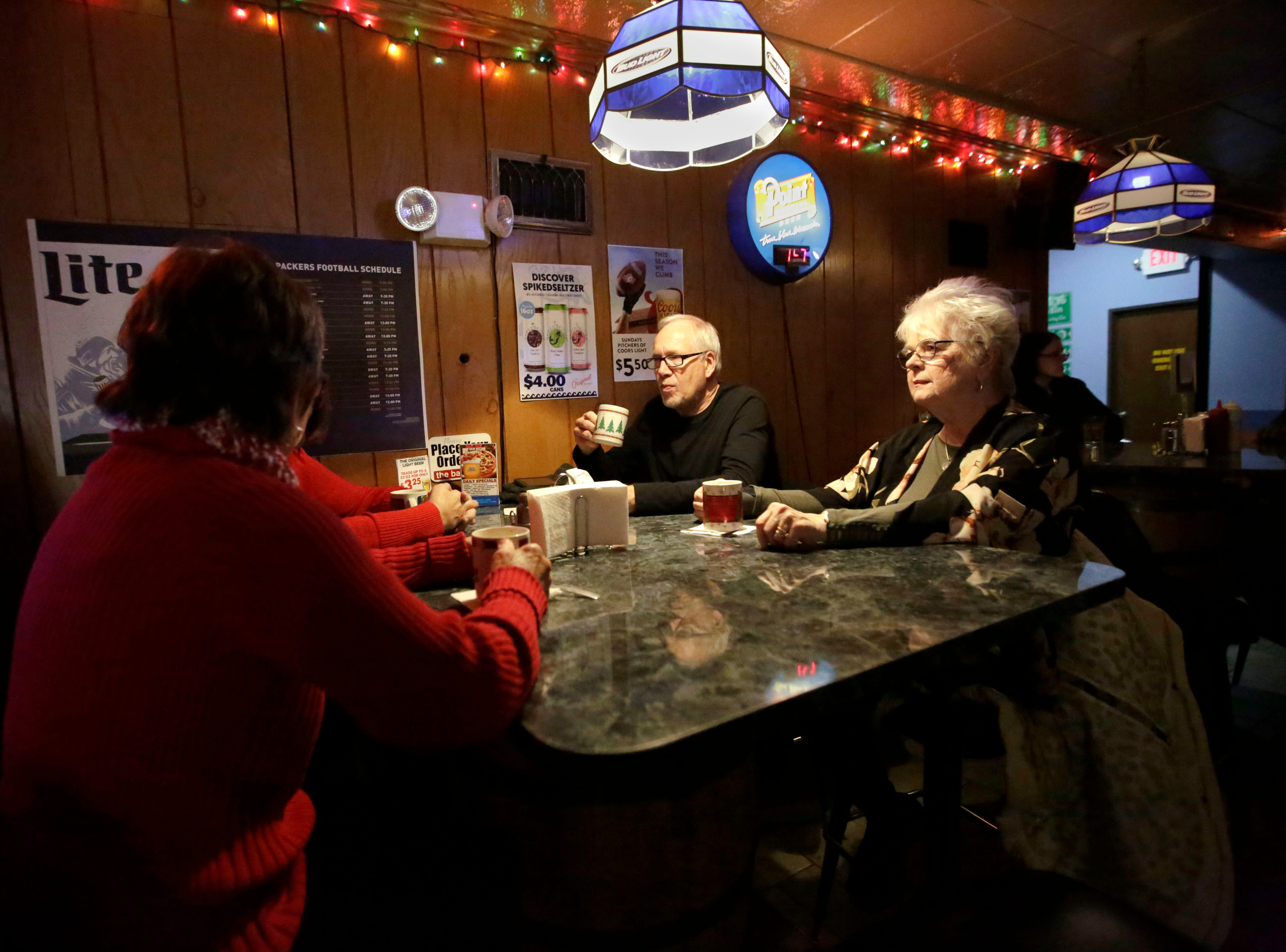 Patrons Barb Peterson, Phil Valitchka and Karen Wentz enjoy Tom and Jerrys on Monday, December 10, 2018, at The Domino Bar in Wausau, Wis. The Domino serves the popular drink every year, from Thanksgiving until New Year's Day.Tork Mason/USA Today NETWORK-Wisconsin