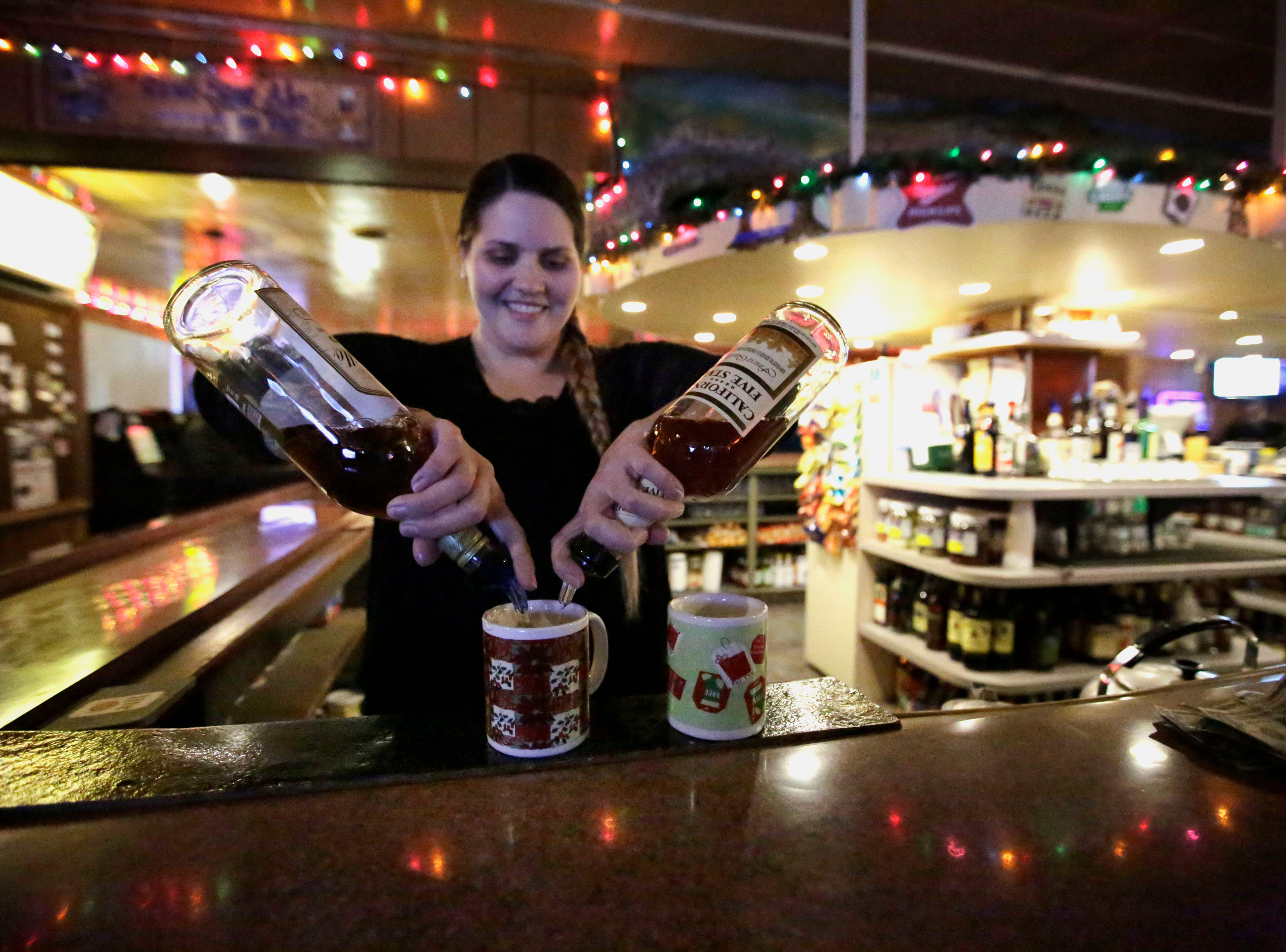 Bartender Alison Weller prepares a pair of Tom and Jerrys on Friday, December 7, 2018, at The Domino Bar in Wausau, Wis. The Domino serves the popular drink every year, from Thanksgiving until New Year's Day.Tork Mason/USA Today NETWORK-Wisconsin