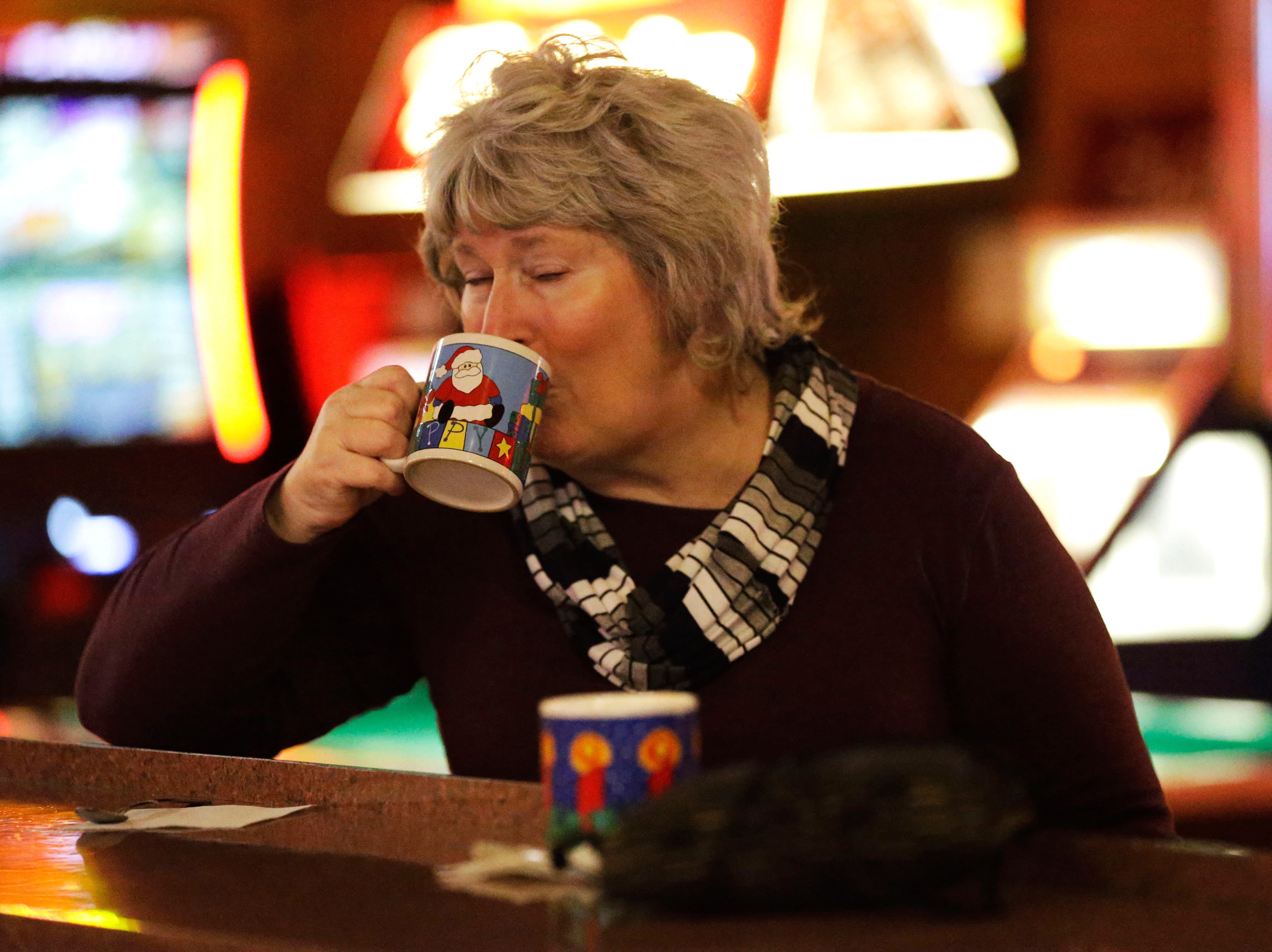 Patron Linda Brandt enjoys a Tom and Jerry on Friday, December 7, 2018, at The Domino Bar in Wausau, Wis. The Domino serves the popular drink every year, from Thanksgiving until New Year's Day.Tork Mason/USA Today NETWORK-Wisconsin