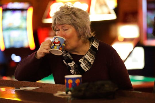 Patron Linda Brandt enjoys a Tom and Jerry on Friday, December 7, 2018, at The Domino Bar in Wausau, Wis. The Domino serves the popular drink every year, from Thanksgiving until New Year's Day.