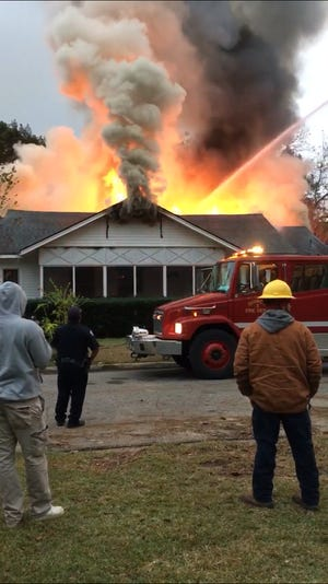 Quincy Fire Department fights a house fire on Highland Avenue on Dec. 10, 2018.