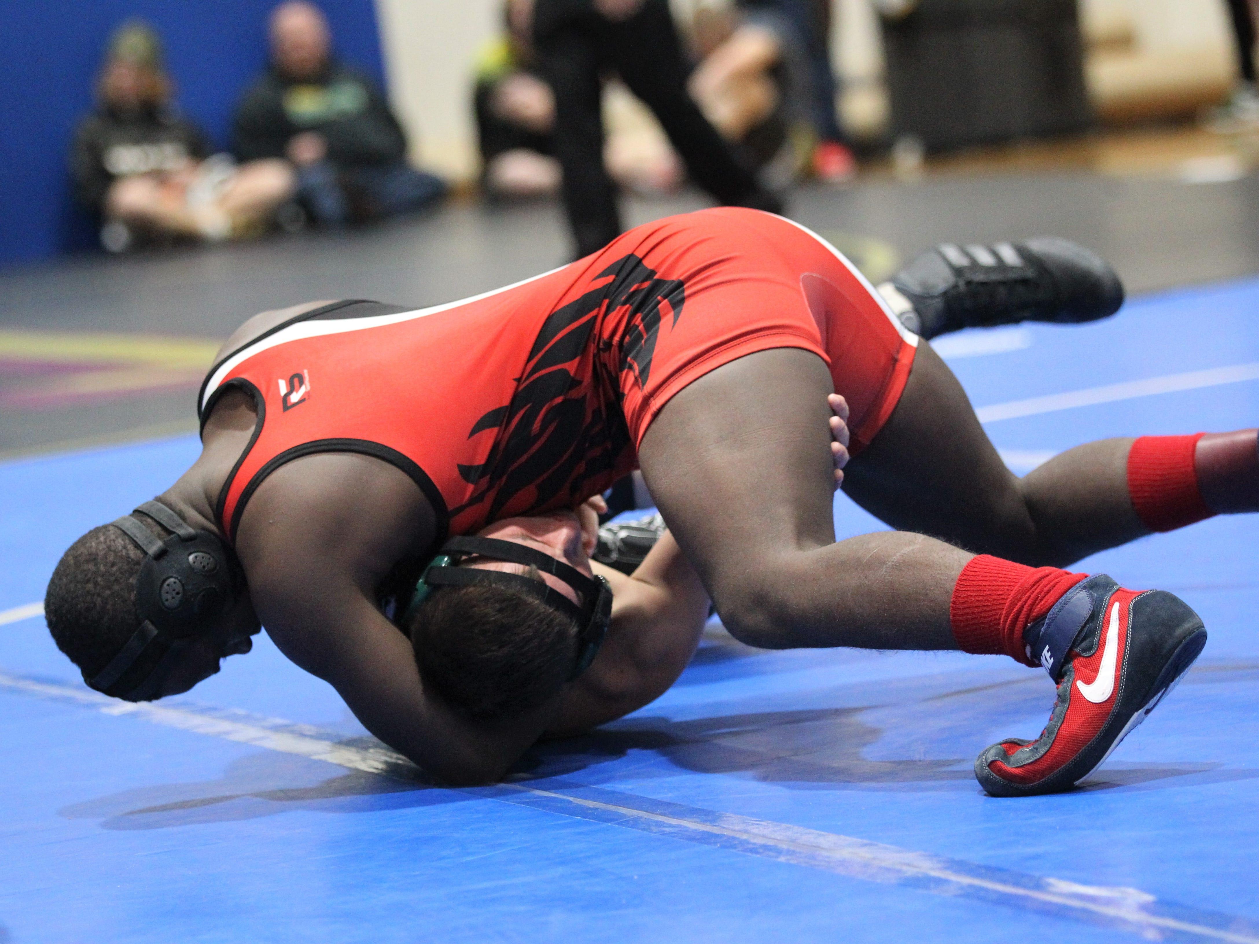 Leon's Jaquenez Madison wrestles at the Cam Brown Seminole Classic wrestling tournament at Florida High on Dec. 7-8, 2018.