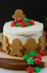 "Gingerbread Cake with Cream Cheese Icing features the ""naked"" decorating style, in which some of the icing is scraped off."