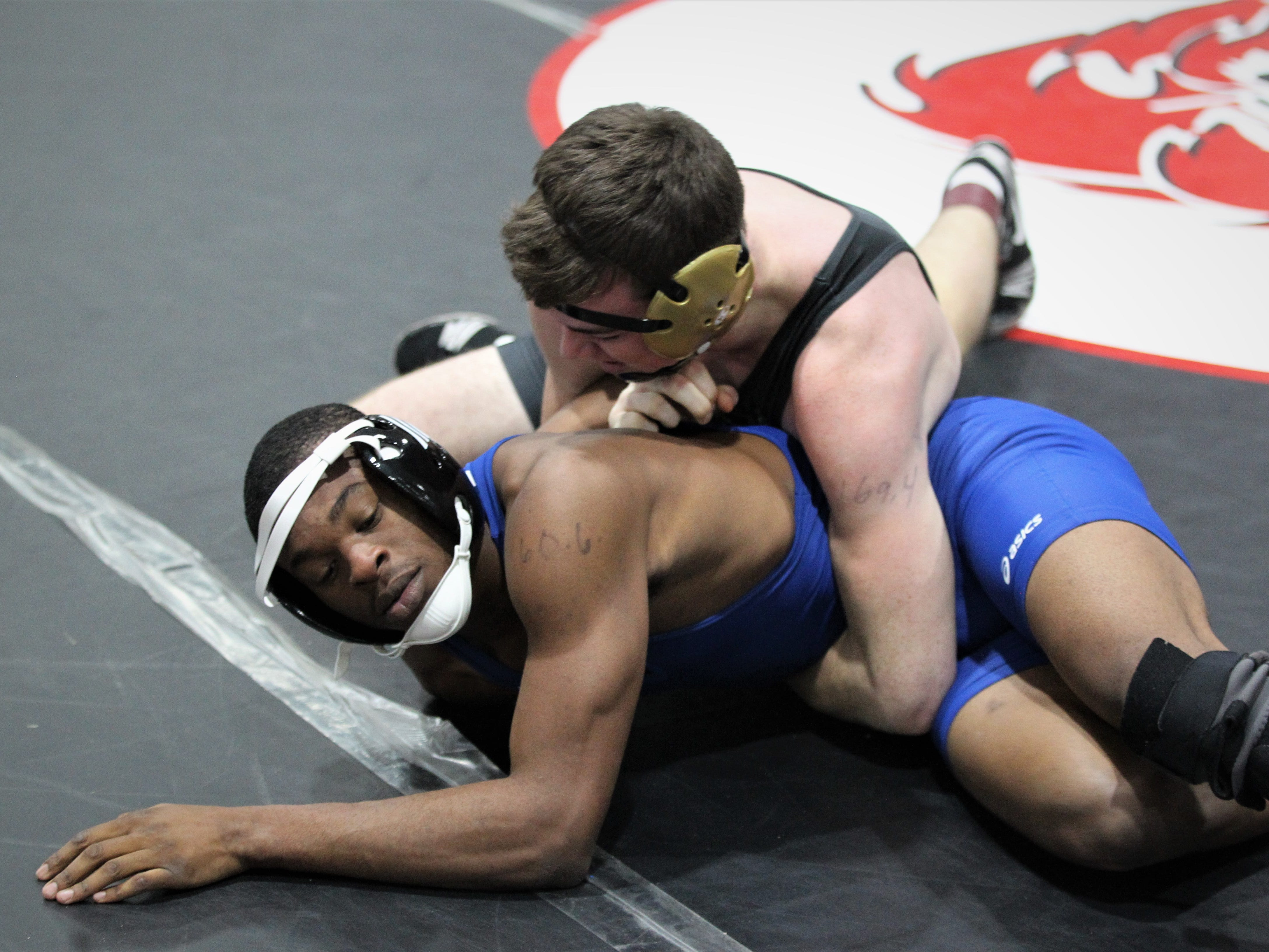 Florida High's Noah Perdue wrestles Rickards' Devin Bailey at the Cam Brown Seminole Classic wrestling tournament at Florida High on Dec. 7-8, 2018.