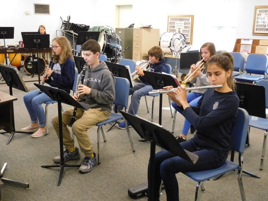 Corzine's band students experience individual instruction and rapid growth.