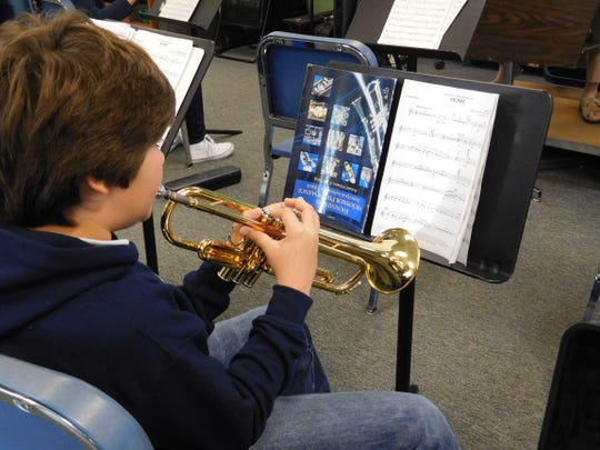 Many of Corzine's band students begin studying with her in the fifth grade.