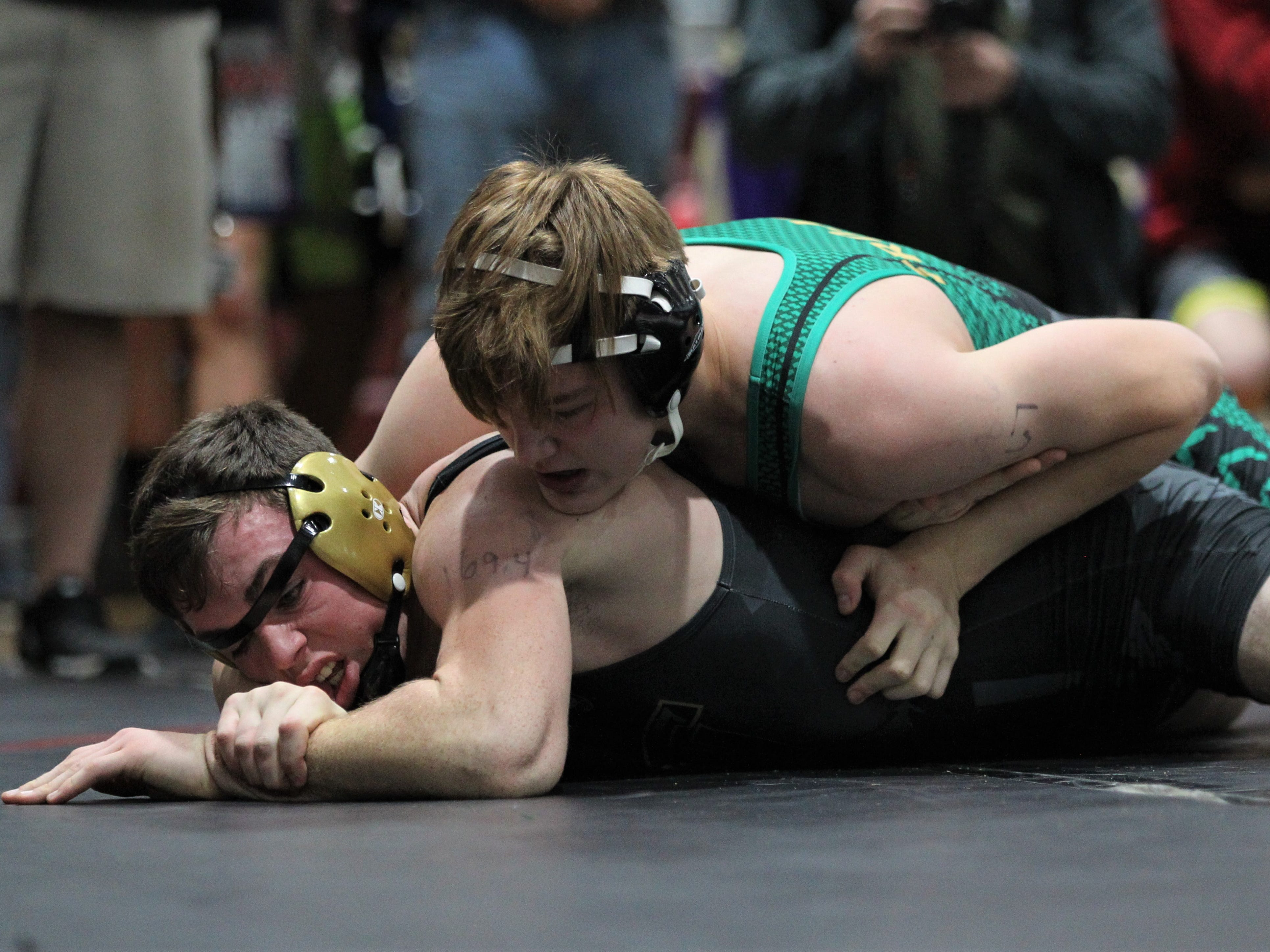 Florida High's Noah Perdue wrestles Lincoln's Cayden Bevis at the Cam Brown Seminole Classic wrestling tournament at Florida High on Dec. 7-8, 2018.