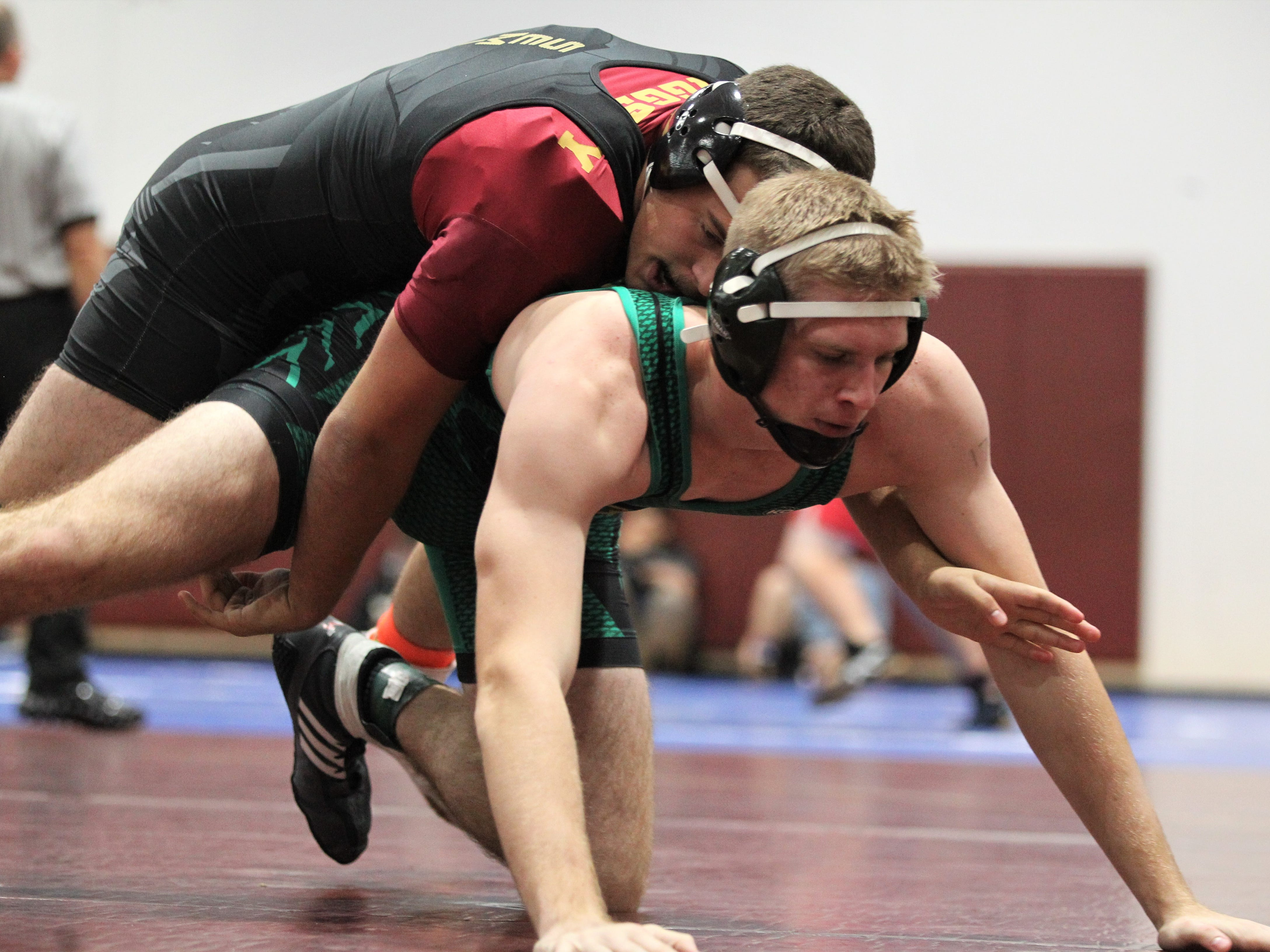 Florida High's Chauncy Riggsby and Lincoln's Andrew Collins wrestle at the Cam Brown Seminole Classic wrestling tournament at Florida High on Dec. 7-8, 2018.