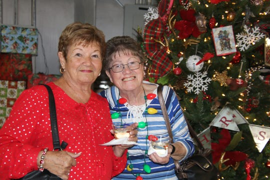 Joan Douglas, left, and Coraljean Dwyer at Mustard Seed Ministries' Silver Bells fundraiser at the St. Lucie County Fairgrounds.
