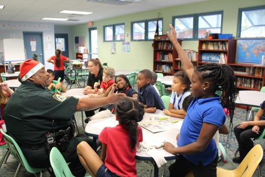 Sheriff Deputy Teddy Floyd fields a question from a Boys & Girls Club member in December 2018.