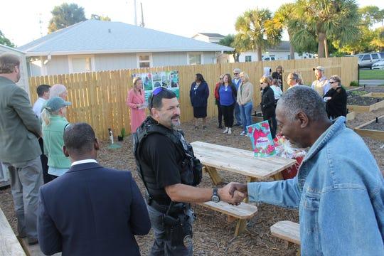 Garden volunteers and City of Stuart employees mingle in the new East Stuart Community Garden.
