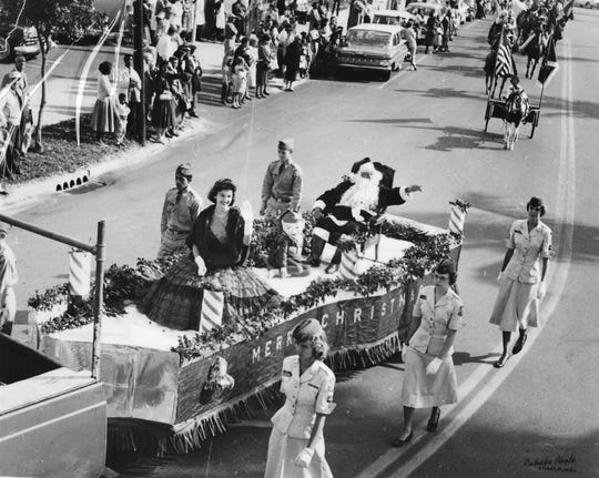 Santa arriving on the float during the Christmas Parade in 1960.