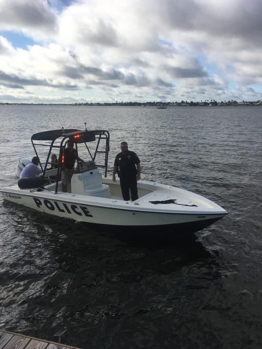 Couple saved by Stuart Police after boat flips