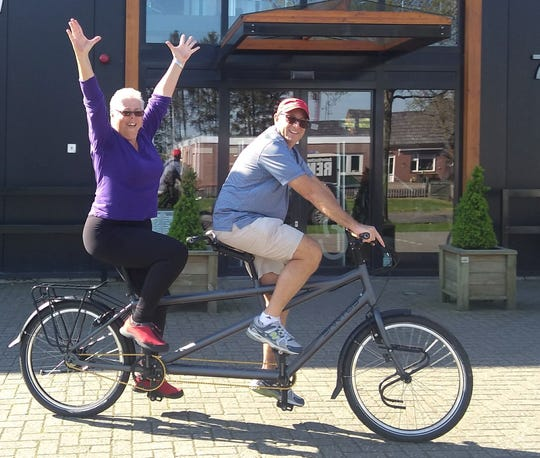 Laura Aaron and her husband Hugh test ride a tandem bicycle in The Netherlands.