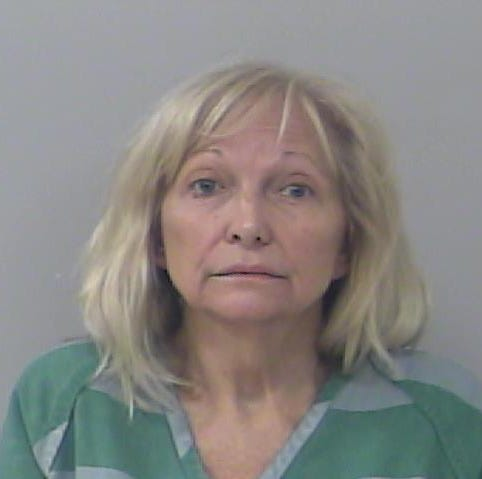 Stuart woman accused of setting home on fire