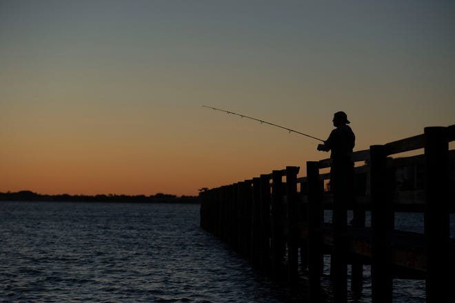 File: Fishing off a pier.