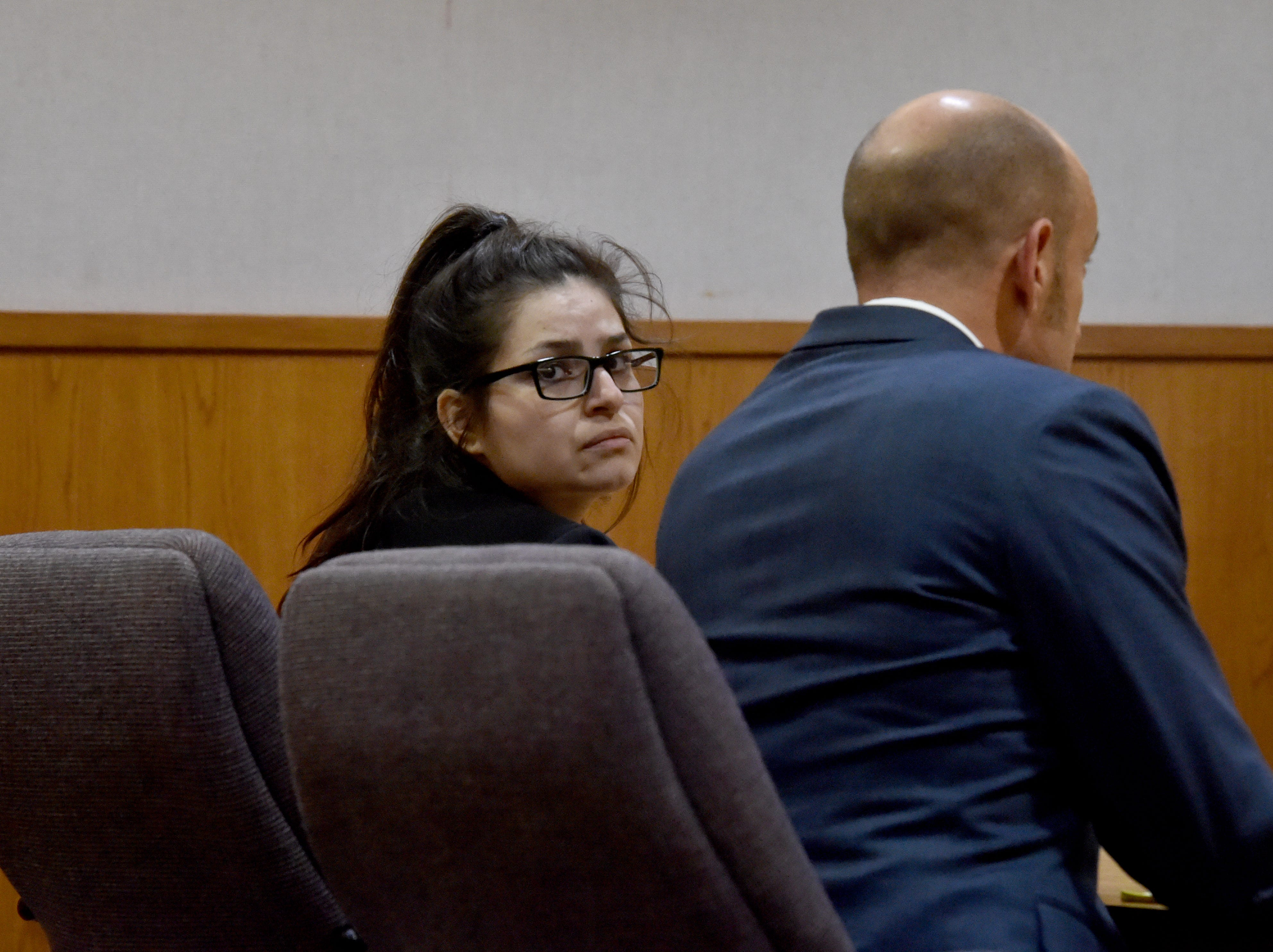 Mayra Chavez looks past her attorney after jurors found her guilty on Monday of the second-degree murder of her 3-year-old daughter Kimberly Lopez. Chavez was also found guilty of assault and torture charges.