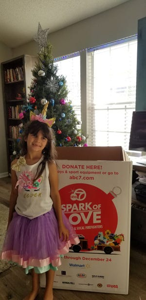 Josie Base, 7, a student at Curren School in Oxnard recently asked guests of her birthday party to bring a toy to be donated to the Spark of Love Toy Drive.