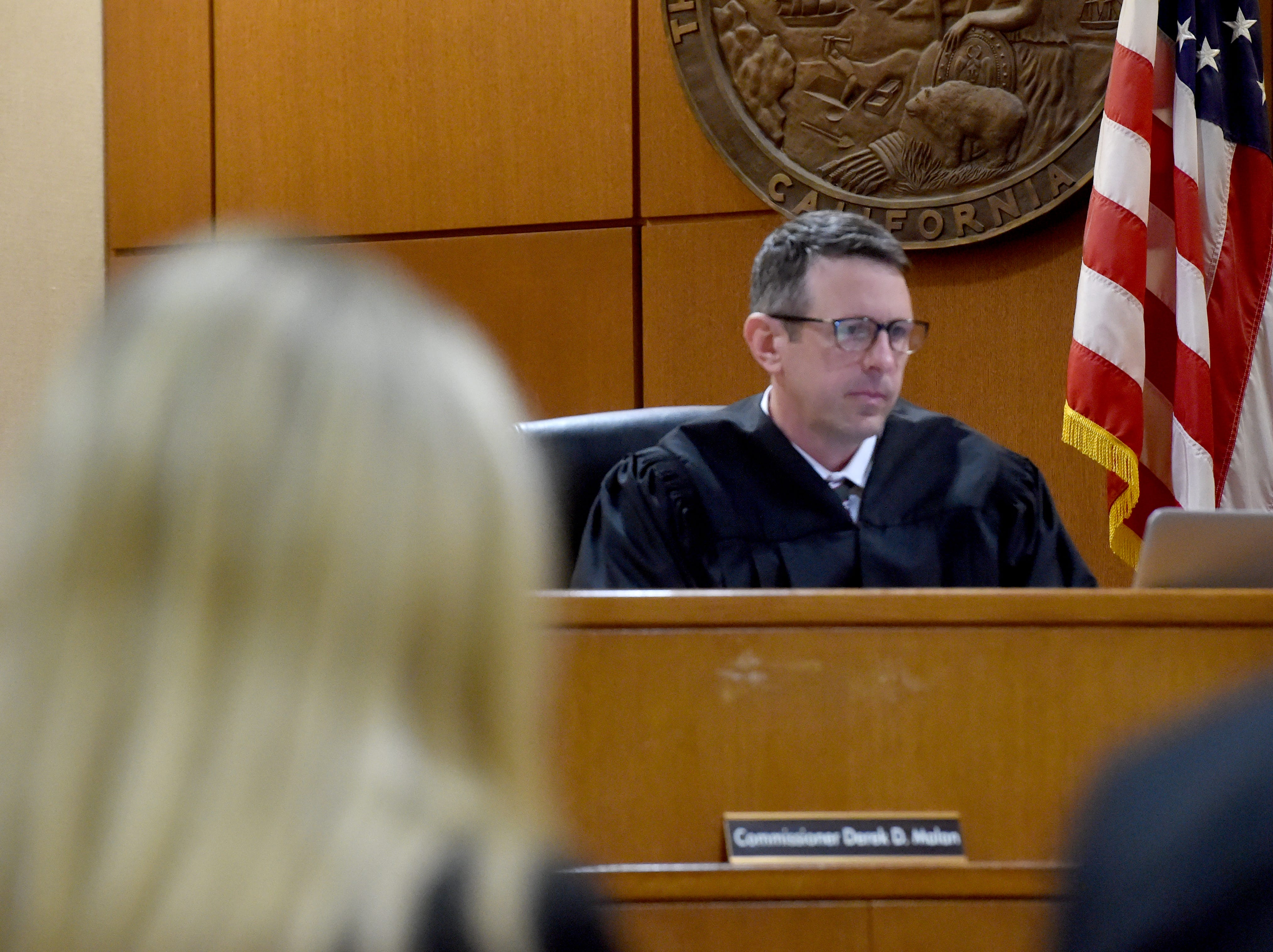 Commissioner Derek Malan listens on Monday as the verdict is read in the trial of Mayra Chavez, who was found guity of second-degree murder of her 3-year-old daughter Kimberly Lopez. Chavez was also found guilty of assault and torture charges.