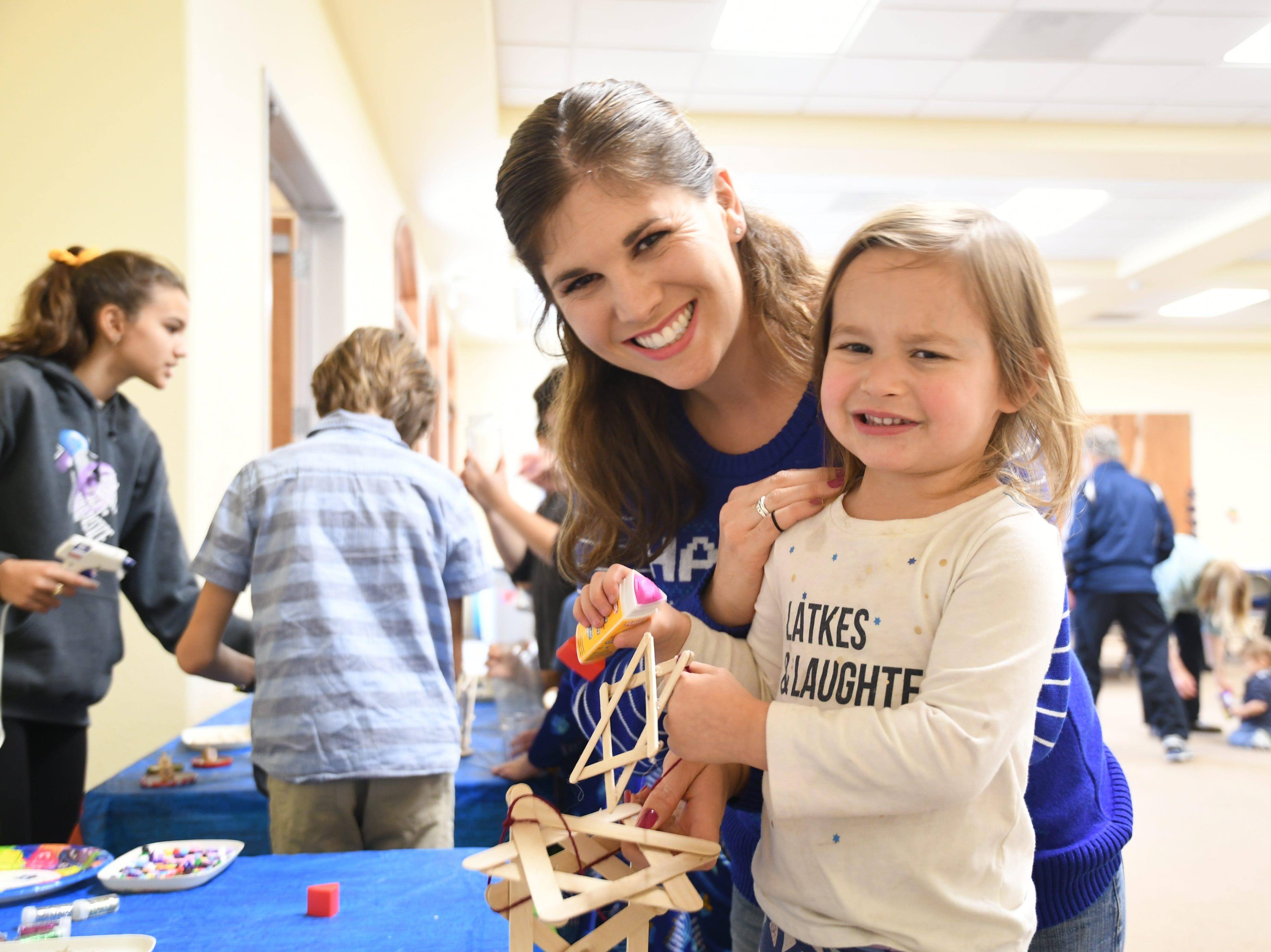 Laura Morell and her daughter Elaina, 3, decorate a Star of David during a Hanukkah celebration at Congregation B'Nai David, Tulare County's only major synagogue.