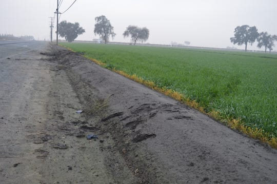 Tire marks lead to an embankment at the fatal officer-involved shooting west of Tulare.