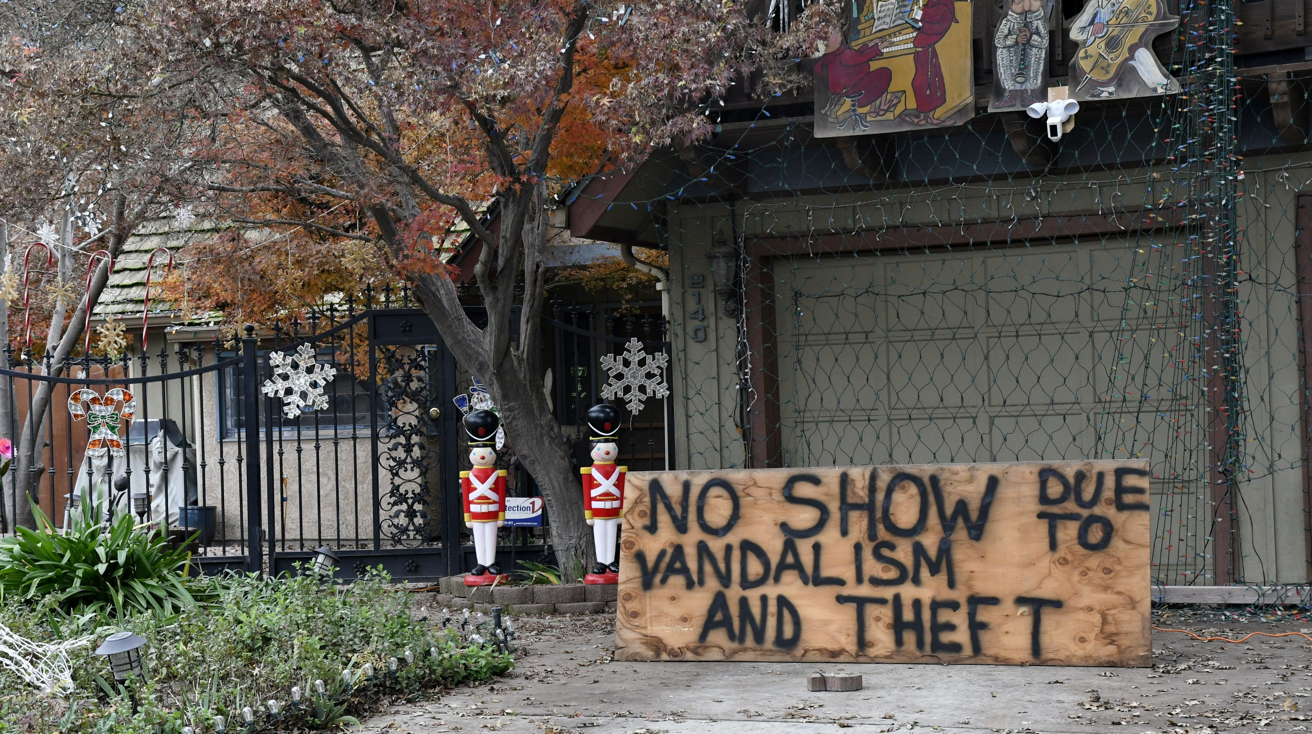 A sign in front of a Visalia home explains the reason a Christmas light show is no longer up and running on Monday, December 10, 2018. The home is one of several hit by vandals over the weekend in the neighborhood near Pinkham Elementary School.