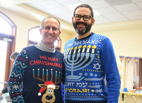 Congregation B'nai David board president Alex Lechtman and Ethan Dutton show off their holiday sweaters - complete with flashing lights.