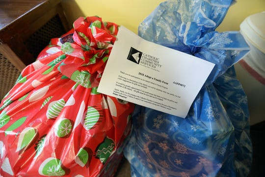 Donated gifts are collected at Catholic Charities Community Services of Rockland in Haverstraw Dec. 7, 2018.