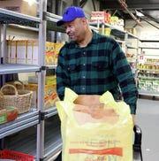 Pierre Desir, pantry manager at People to People in West Nyack Dec. 6, 2018.