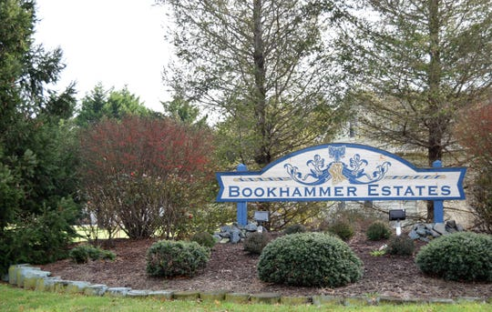 "The homeowners association at Bookhammer Estates, a ""premier upscale residential community"" off Route 24 near Rehoboth Beach and Lewes, is suing the president of the Correctional Officers Association of Delaware and his wife for failing to pay assessment fees it says are needed for road paving."