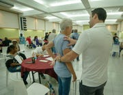 Dr. Kirill Alekseyev (right), the medical director for Post Acute Medical in Dover, works with a patient during a medical mission to Puerto Rico in November. Alekseyev is involved with Community Health Alliance of Medical Professionals (C.H.A.M.P.), a nonprofit organization dedicated to providing medical disaster relief all around the world.