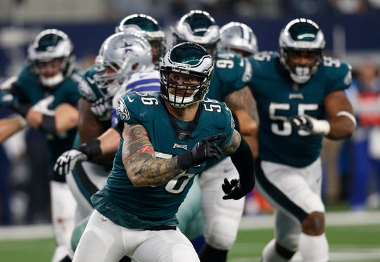 Philadelphia Eagles defensive end Chris Long (56) signals as he covers against the Dallas Cowboys during the first half of the game Dec. 9.