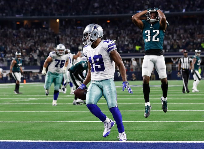 Dallas Cowboys wide receiver Amari Cooper (19) scores a 15-yard touchdown against the Philadelphia Eagles in overtime of an NFL football game, in Arlington, Texas, Sunday, Dec. 9, 2018. Dallas won 29-23. (AP Photo/Roger Steinman)