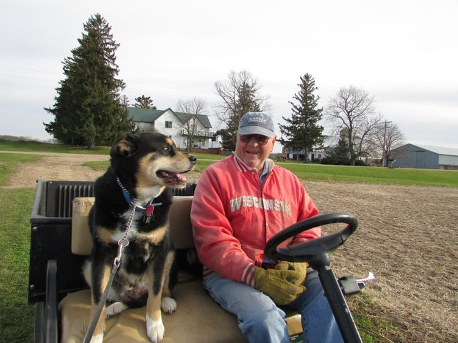 Sunny joins Bob for a cart ride on the farm.