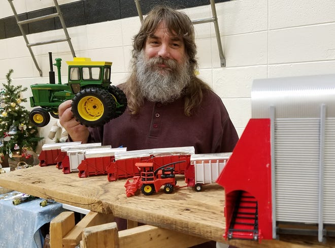 Mike Docter of Brandon gives Santa some assistance this year building special farm toys.
