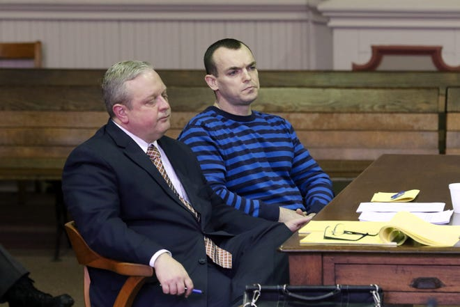 John Iden listens to closing arguements by the state while seated next to his attorney Jeff Blosser in Muskingum County Common Pleas Court on Monday.