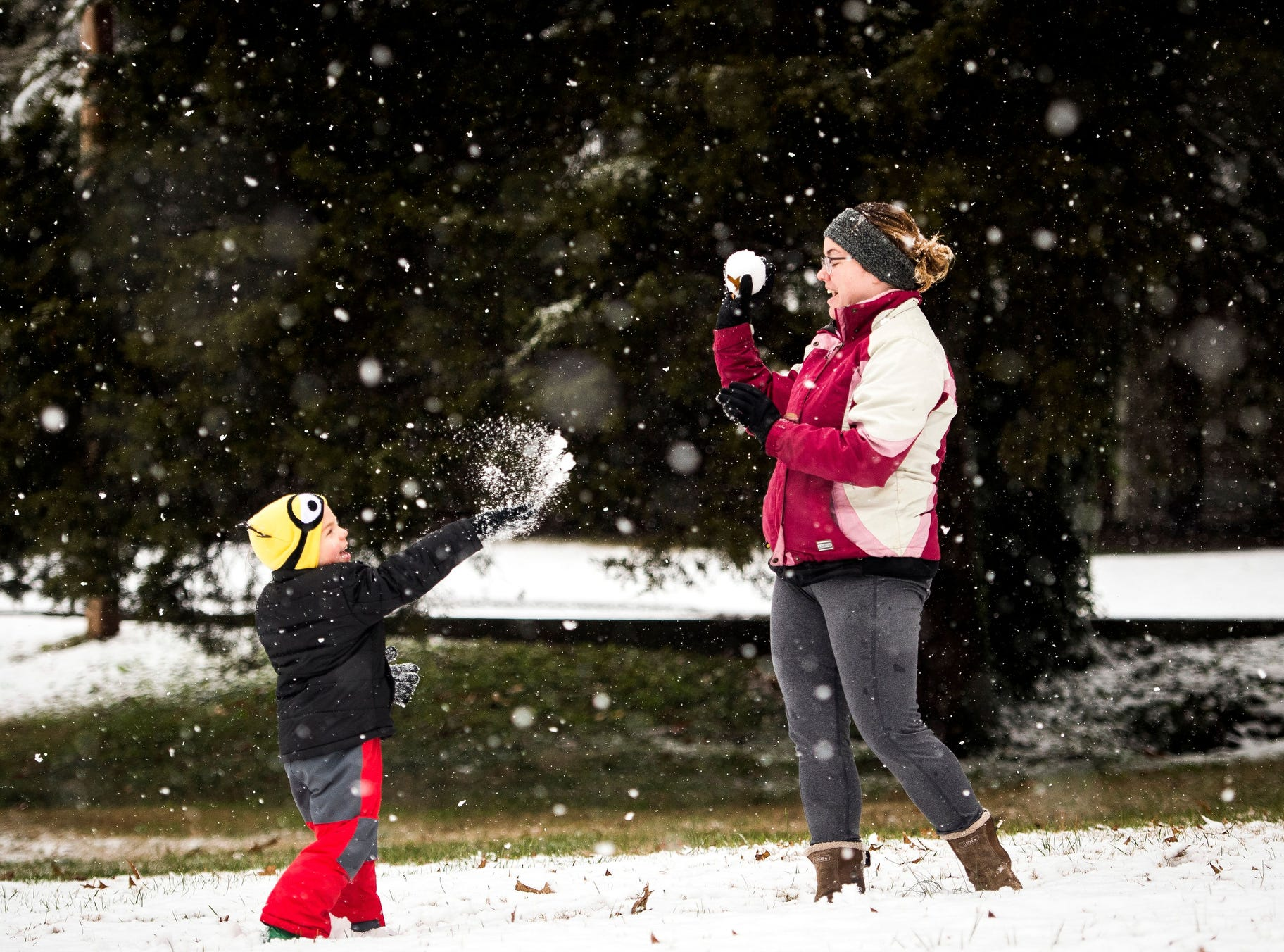 Shannon Choppert, right, and son Parker make and throw snowballs off of Sunflower Rd. in Knoxville, Tenn.