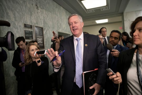 Rep. Mark Meadows, R-N.C., chairman of the conservative House Freedom Caucus, is met by reporters on Capitol Hill in Washington, D.C., Dec. 7, 2018.