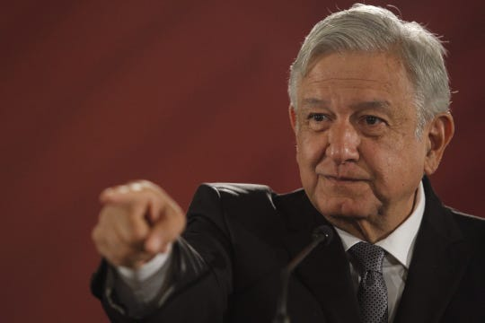 Mexican President Andres Manuel Lopez Obrador speaks right thru a press convention on the Treasury Hall of the National Palace in Mexico City, Mexico, on Dec. 5, 2018.