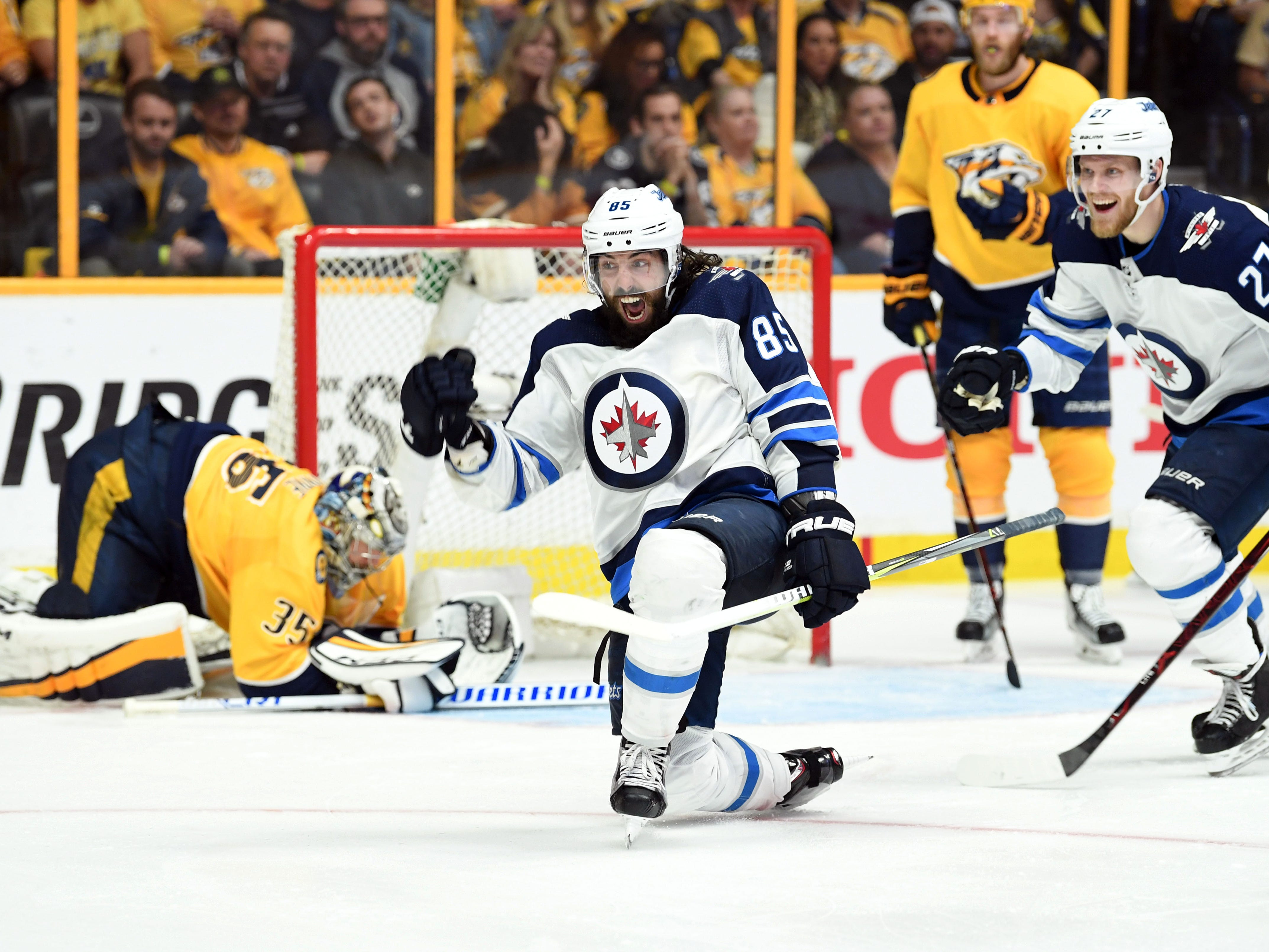 May 5: Winnipeg Jets center Mathieu Perreault (85) celebrates after scoring past Nashville Predators goalie Pekka Rinne (35) during the third period of Game 5 in their second-round series.