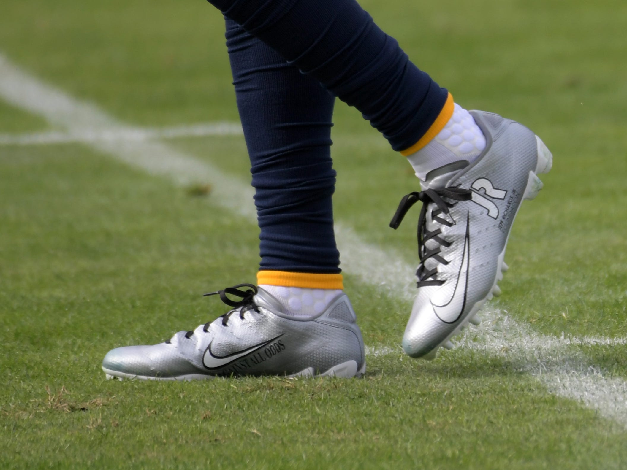 Los Angeles Chargers defensive back Jeff Richards wears personalized Nike cleats as part of the My Cause My Cleats campaign during the game against the Cincinnati Bengals at StubHub Center.
