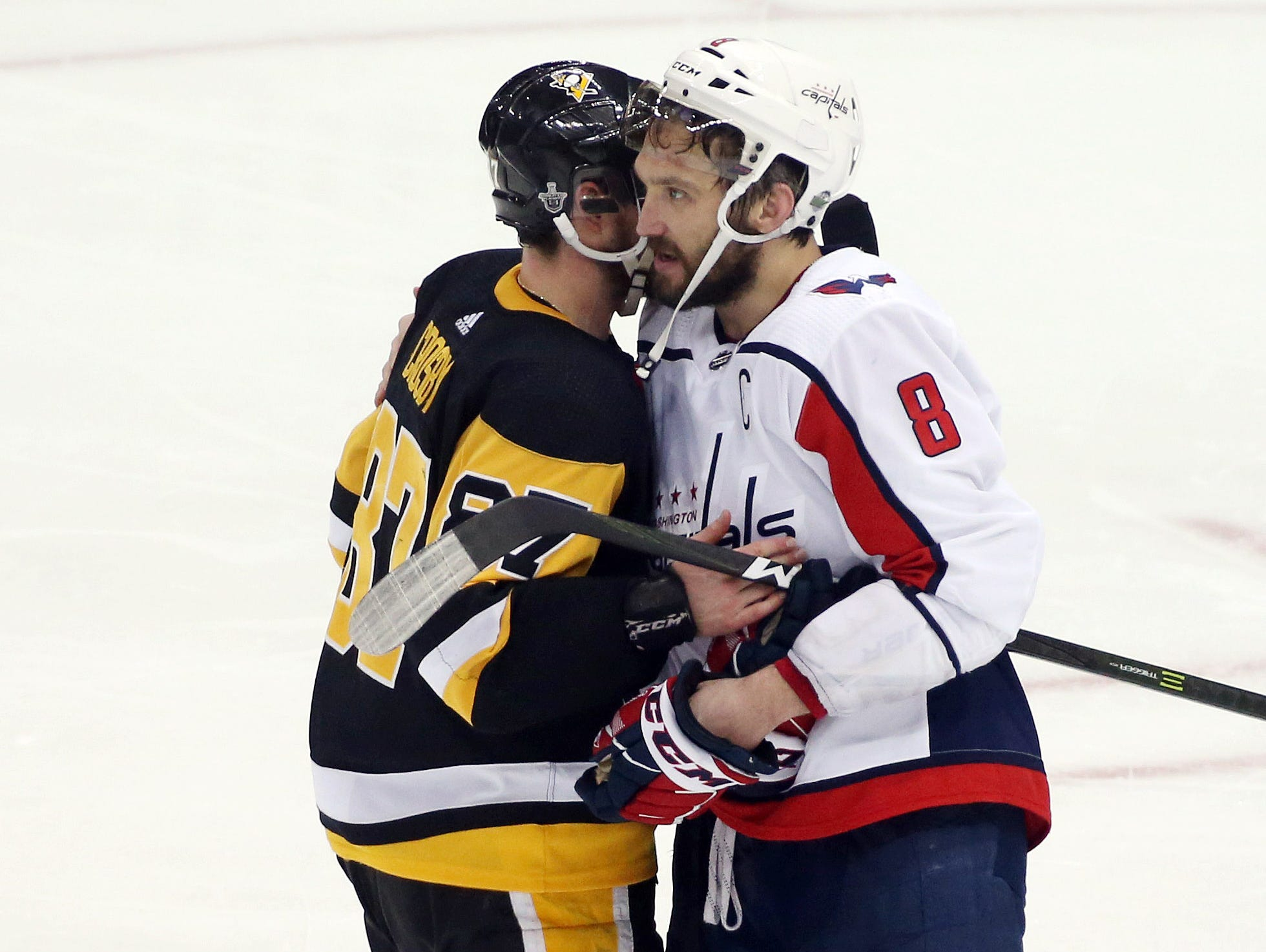 May 7: Pittsburgh Penguins center Sidney Crosby (87) and Washington Capitals left wing Alex Ovechkin (8) embrace after Game 6 of their second-round series, the first playoff round between the pair won by Ovechkin's team.