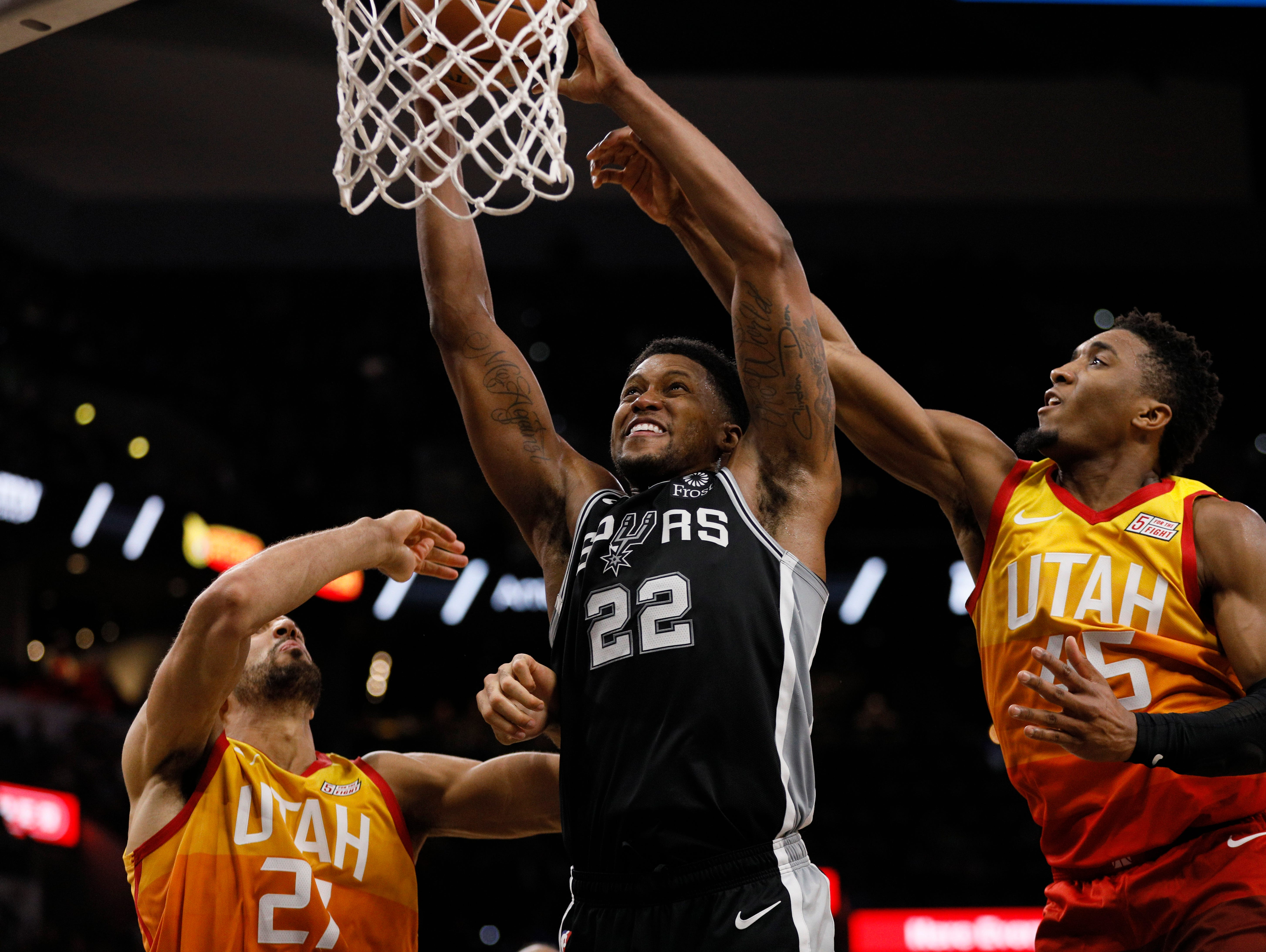 Dec. 9: Spurs forward Rudy Gay (22) goes up strong for the two-handed slam between Jazz defenders Rudy Gobert (27) and Donovan Mitchell (45) during the second half in San Antonio.